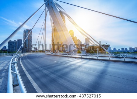 modern buildings with empty road under blue sky,tianjin china. #437527015