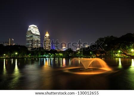 Modern business area at night in Bangkok, Thailand - stock photo