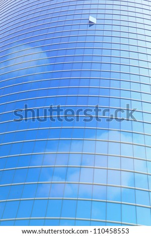 modern business building and window reflection the blue sky and cloud