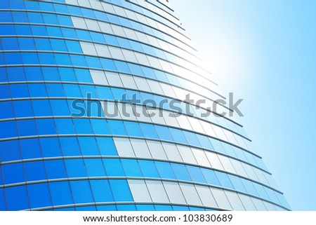 modern business building on a background of the blue sky and sunshine