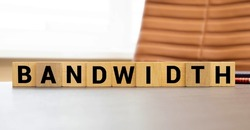 Modern business buzzword - bandwidth. Top view on wooden table with blocks. Top view.