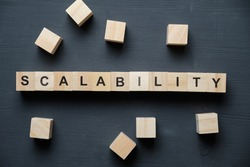 Modern business buzzword - scalability. Top view on wooden table with blocks. Top view. Close up.