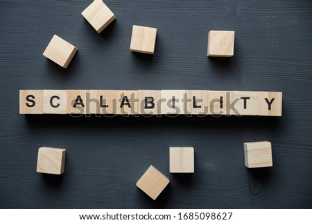 Modern business buzzword - scalability. Top view on wooden table with blocks. Top view. Close up. Foto d'archivio ©