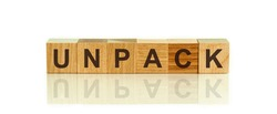 Modern business buzzword - unpack. Word on wooden blocks on a white background. Close up