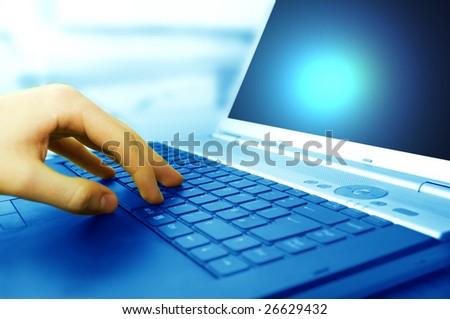 Modern business equipment. Typing on keyboard