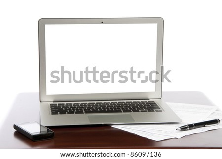 Modern Business  laptop notebook computer screen, cellular mobile phone, pen and documents at the office work table isolated on white background