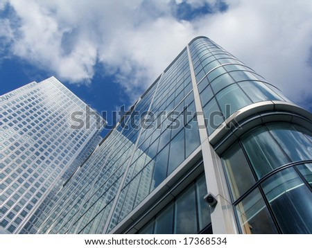 Modern business skyscraper in Canary Wharf, London. Skyscrapers are with clipping path.