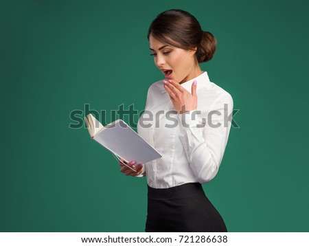 Modern business woman holds a notebook in hand #721286638