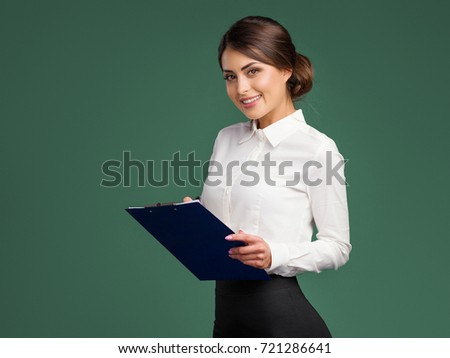 Modern business woman holds documents and a pen in hand #721286641