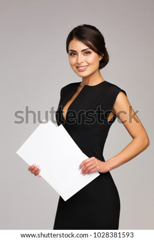 Modern business woman holds documents in hand #1028381593
