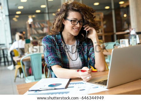 Modern business woman in city cafe. Surfing the web. #646344949