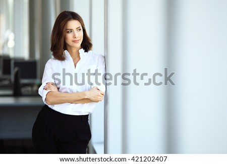 Shutterstock Modern business woman in the office with copy space