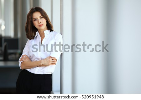 Modern business woman in the office with copy space