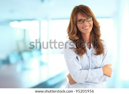Modern business woman in the office with copy space - stock photo
