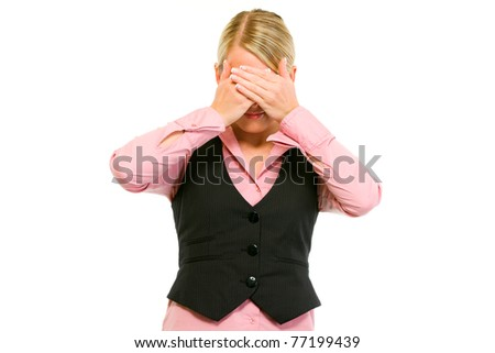 Modern business woman making see no evil gesture isolated on white