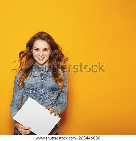 Modern business woman over yellow background with copy space. Hipster style. Studio fashion portrait