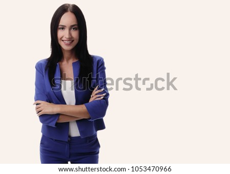 Modern business woman smiling and standing over a white backgrou #1053470966