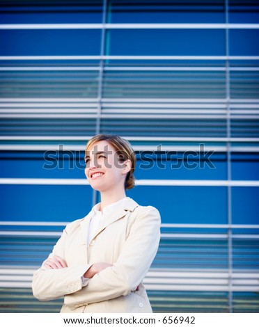 Modern business woman stands with smile