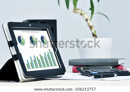 Modern business workplace with digital tablet, calculator, pen