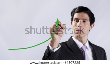 Modern businessman writing the business stats progress in the whiteboard (selective focus)