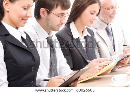 Modern businesspeople at a seminar