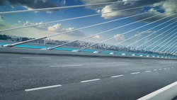 Modern cable-stayed bridge speedway with cityscape .Side angle view . Morning scene .