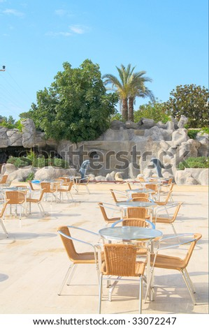 Modern cafe furniture on the resort by summer.