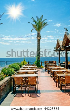 Modern cafe furniture on the resort by summer. Turkey.