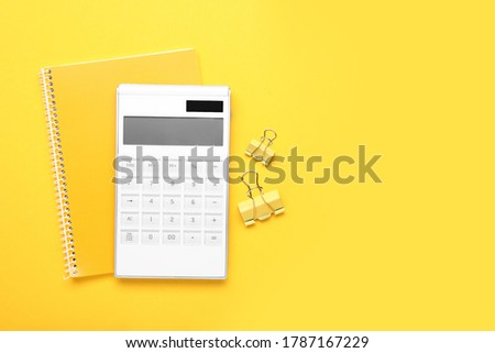 Modern calculator with stationery on color background stock photo