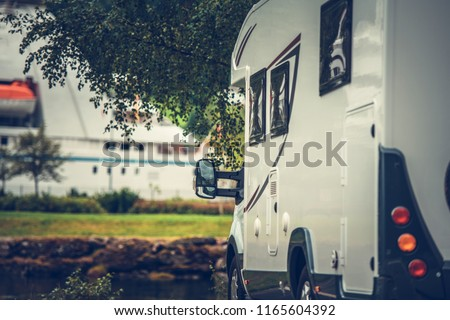 Modern Camper Van on the Campsite. Motorhome Vacation Time. #1165604392