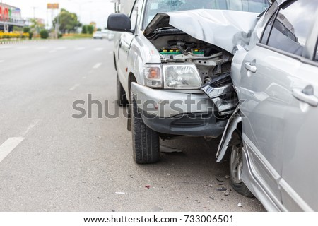 Modern car accident involving two cars on the road in Thailand #733006501