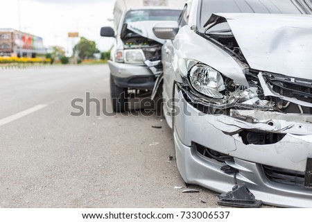 Modern car accident involving two cars on the road in Thailand #733006537