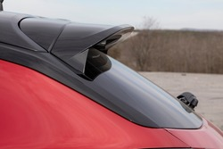 modern car, active aerodynamic wing spoiler at the trunk of automobile