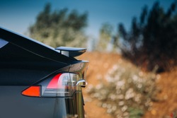 Modern car active aerodynamic wing spoiler at the trunk of electric suv