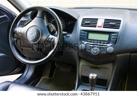 Modern car dashboard and front seats view - stock photo