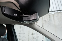 Modern Car DVR installed near the mirror.