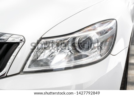 Modern car headlight, car exterior detail #1427792849
