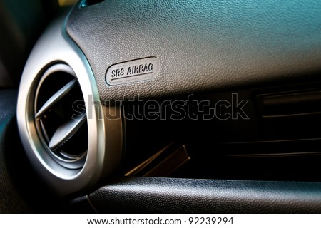 modern car interior, passenger airbag and air conditioning hole