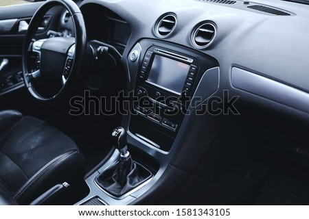 Modern car interior: steering wheel, gearshift lever, multimedia system, driver's seat and dashboard.  Stock photo ©