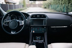 Modern car interior. White leather seats and dashboard inside modern suv