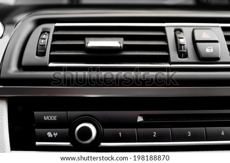 modern car interior with close-up of ventilation system holes and air conditioning. Concept wallpaper for auto air conditioning and climate control