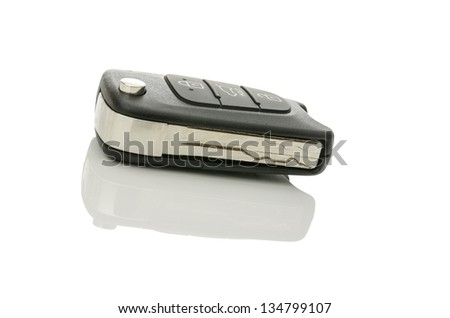 Modern car key isolated over white background.