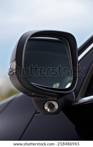 Modern car mirror with blind spot camera