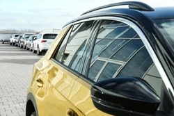 Modern car with tinting foil on window outdoors, closeup