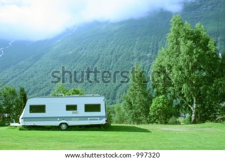 modern caravan standing at the campsite in the mountains