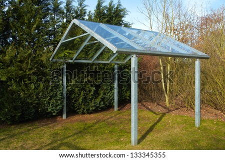 Modern carport car garage parking made from metal and glass