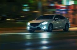 modern cars go on the night city