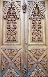 Modern carved wooden entrance door in the church building, Kharkov, Ukraine.