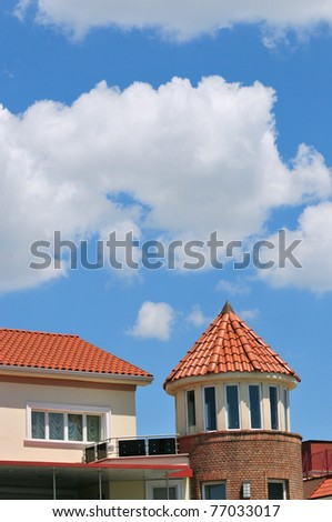 Modern castle tower house with red tiles - stock photo