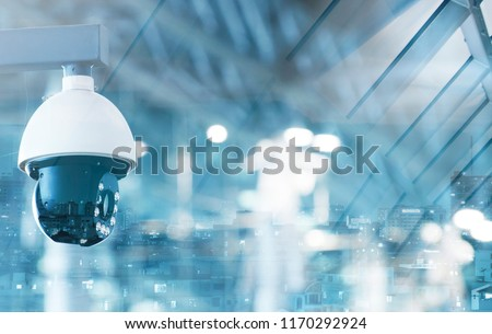 modern CCTV camera on a wall. A foggy day in a city background  image double exposure mock up